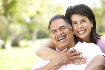Man & Woman with Dental Implants